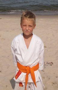 Jakub Mikołajewski – 7 Kyu (pomarańczowy pas)